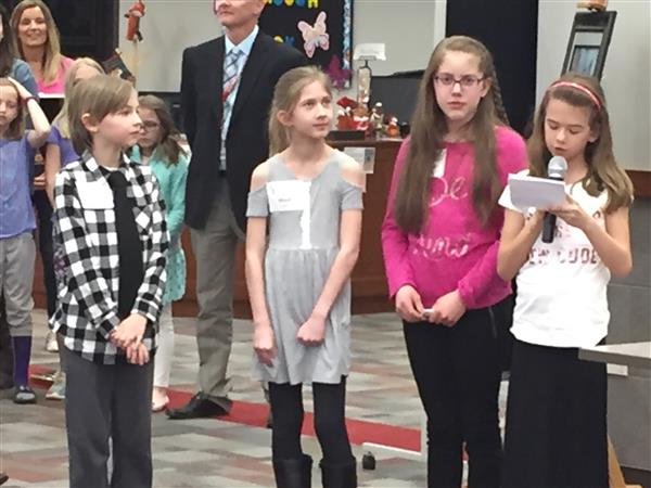YIS students presenting heart of the fox at a BOE meeting