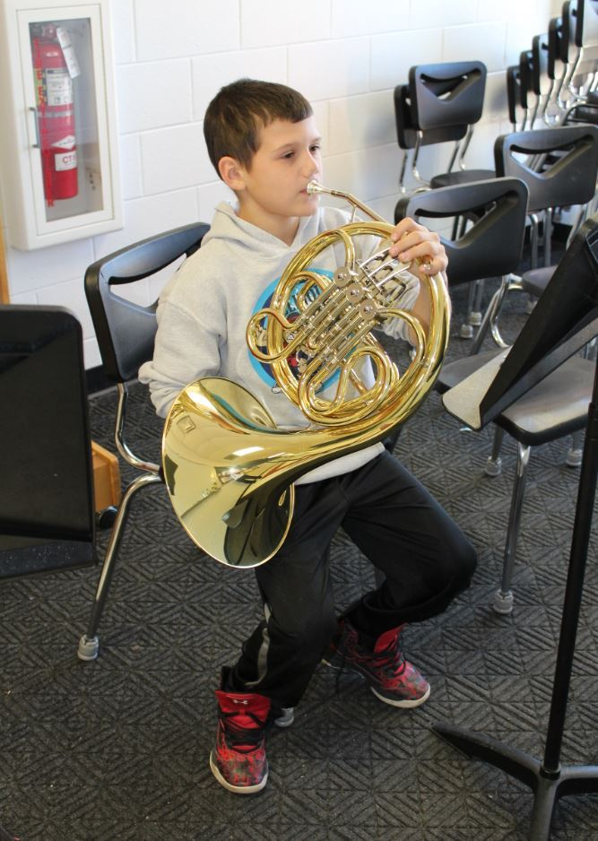 Boy playing French Horn