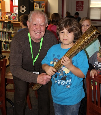 Volunteer and student with the Olympic Torch
